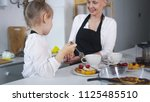 young mother with her child... | Shutterstock . vector #1125485510