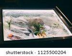 mini fridge in the form of a... | Shutterstock . vector #1125500204