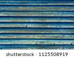old shabby painted wooden wall. ... | Shutterstock . vector #1125508919