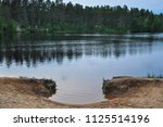 forest lake landscape with pine ...   Shutterstock . vector #1125514196