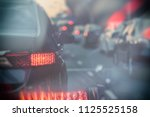 traffic jam with row of cars on ... | Shutterstock . vector #1125525158