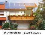 solar panels on red roof modern ...   Shutterstock . vector #1125526289