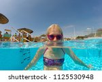 young woman enjoying in the... | Shutterstock . vector #1125530948