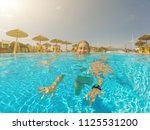 young woman enjoying in the... | Shutterstock . vector #1125531200