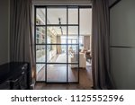 partially opened entrance to... | Shutterstock . vector #1125552596