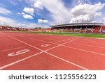 athletics stadium running track ... | Shutterstock . vector #1125556223