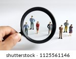 magnifier and miniature people. ... | Shutterstock . vector #1125561146