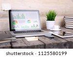analyzing statistics on laptop...   Shutterstock . vector #1125580199