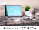 analyzing statistics on laptop...   Shutterstock . vector #1125580736