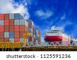 container ship in port waiting... | Shutterstock . vector #1125591236