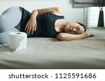 asian woman with morning... | Shutterstock . vector #1125591686
