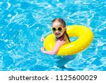 child with sunglasses in... | Shutterstock . vector #1125600029
