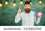 teacher in eyeglasses holds... | Shutterstock . vector #1125601544