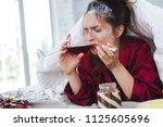 huge stress. dark haired woman... | Shutterstock . vector #1125605696