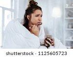 watching melodrama. woman... | Shutterstock . vector #1125605723