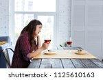 in despair. beautiful charming... | Shutterstock . vector #1125610163
