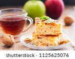 two pieces of homemade apple... | Shutterstock . vector #1125625076