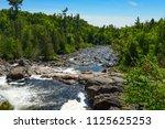 sand river with a rock garden... | Shutterstock . vector #1125625253