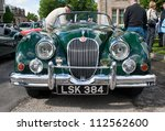 GRANTOWN ON SPEY, SCOTLAND - SEPTEMBER 2: Jaguar XK150 on display in the annual Motor Mania car show on September 2, 2012 in Grantown On Spey, Scotland - stock photo