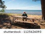 senior man looking at a map | Shutterstock . vector #1125626093