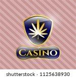 golden badge with weed leaf... | Shutterstock .eps vector #1125638930