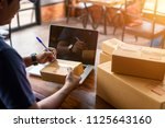 delivery man are checking... | Shutterstock . vector #1125643160