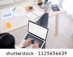 top view of woman use laptop... | Shutterstock . vector #1125656639
