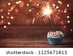 cupcake with sparkler on old...   Shutterstock . vector #1125671813