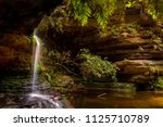 serenity at a little waterfall... | Shutterstock . vector #1125710789