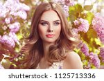 beautiful woman with flowers of ... | Shutterstock . vector #1125713336