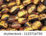 fried chestnuts on the street.... | Shutterstock . vector #1125716750