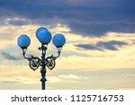 vintage street lights against... | Shutterstock . vector #1125716753