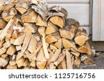 chopped firewood pieces orderly ... | Shutterstock . vector #1125716756