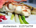 cooked white fish with spring... | Shutterstock . vector #1125716759