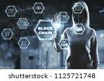 back silhouette of a hacker... | Shutterstock . vector #1125721748