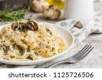 pasta fettuccine with mushrooms ... | Shutterstock . vector #1125726506