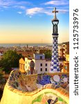 Small photo of Barcelona, Spain: Park Guell. View of the city from Park Guell in Barcelona sunrise. Park Guell by architect Antoni Gaudi