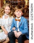 two cute children in elegant...   Shutterstock . vector #1125736094