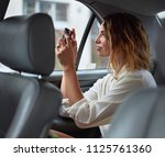 woman taking pictures while... | Shutterstock . vector #1125761360