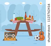 summer wooden picnic table on... | Shutterstock .eps vector #1125762416