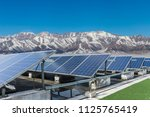 solar energy with snow mountain | Shutterstock . vector #1125765419