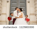 just married. newlyweds are... | Shutterstock . vector #1125803300