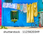 colorful houses in burano and... | Shutterstock . vector #1125820349