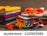 a pile of warm autumn clothes.... | Shutterstock . vector #1125825383