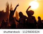 sunset party dancers... | Shutterstock . vector #1125830324