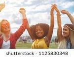 friends dancing with hands in... | Shutterstock . vector #1125830348