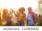 multiethnic girls covered in... | Shutterstock . vector #1125830630