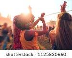 multiethnic girls covered in... | Shutterstock . vector #1125830660