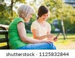 grandmother and granddaughter... | Shutterstock . vector #1125832844