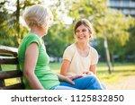 grandmother and granddaughter... | Shutterstock . vector #1125832850